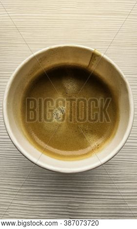 Top View Hot Coffee In Paper Cup Or Takeaway Cup On Table, Close Up To Coffee In Paper Cup, Vertical