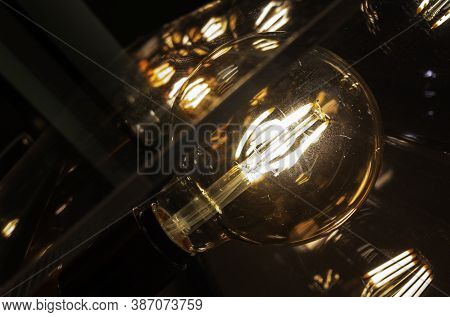 Close Up Vintage Light Bulbs In Cafe, Dark Tone With Orange Light.