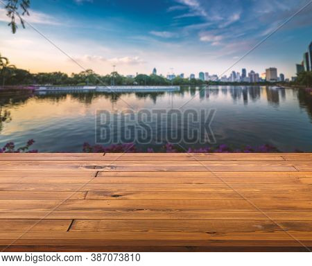 Beautiful Plank Wooden Table, Perspective View, Empty Space For Product Display. Blurred Background