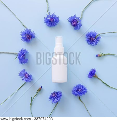 Top View And Close-up Of Mockup Of Unbranded White Plastic Spray Bottle And Floral Frame Of Blue Low