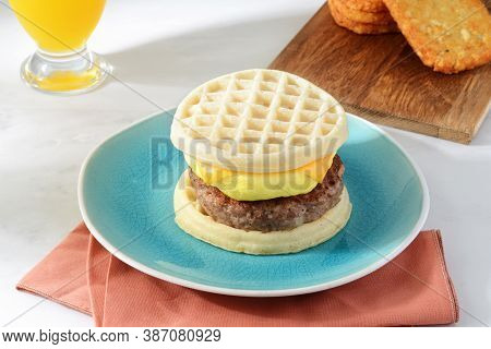 Breakfast Sausage Egg Cheese Waffles Sandwich With Hash Browns