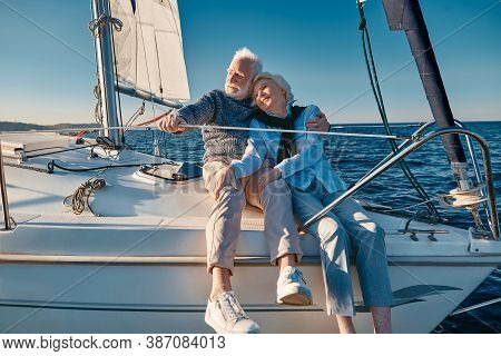 Enjoying Sailing. Happy Lovely Senior Family Couple Hugging And Relaxing On A Sail Boat Or Yacht Dec