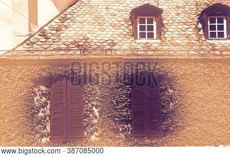 Deserted House In France At Dawn In A Contemporary Style. Facade Of A Stone House Decorated With Wil