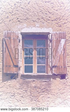 Typical French Window With Open Wooden Shutters, Non Decorated With Fresh Flowers In Faded Color Eff