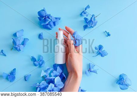 Top View And Close-up Of Female Hand, White Plastic Spray Bottle Mockup With Hydrangea Flowers On A