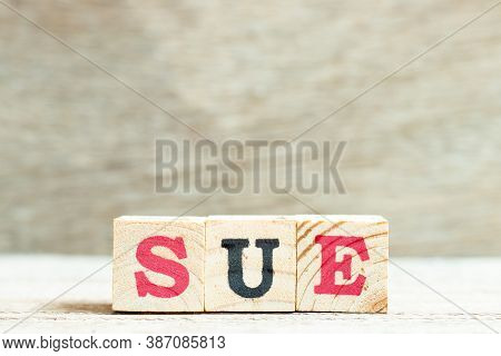Alphabet Letter In Word Sue On Wood Background