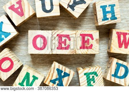 Alphabet Letter Block In Word Oee (abbreviation Of Overall Equipment Effectiveness) With Another On