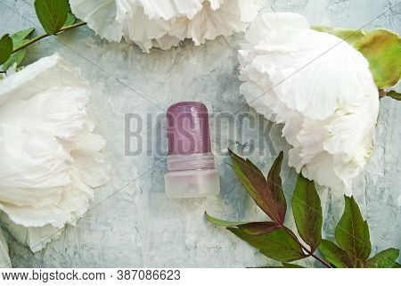 Natural Cosmetic. Natural Deodorant Made From Crystalline Alum Against A Background Of Peonies. Gree