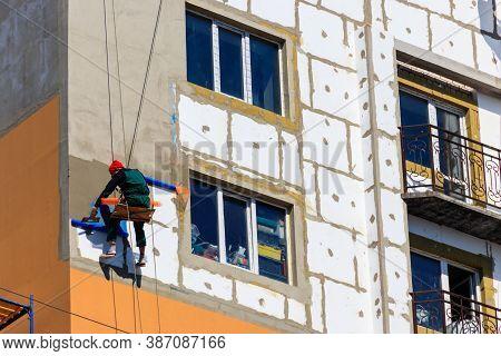 Kremenchug, Ukraine -april 3, 2020: Styrofoam Insulation Of High-rise Building. Rope Access Working.