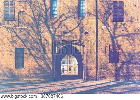 Whimsical Shade Of Trees In The Courtyard Of The Duke Of Gonzaga's Palace In Mantua In Faded Color E