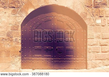 Closed Massive Wooden Door In Italy As A Symbol Of Restricting Tourism At Dawn In A Contemporary Sty