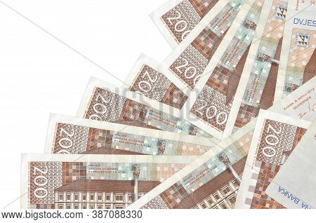 200 Croatian Kuna Bills Lies In Different Order Isolated On White. Local Banking Or Money Making Con