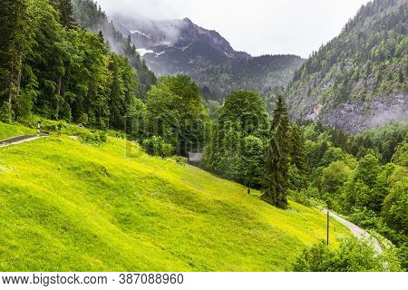 Morning Mist Over The Austrian Landscape With Forests, Mountains, Pastures, Meadows And Villages.  R