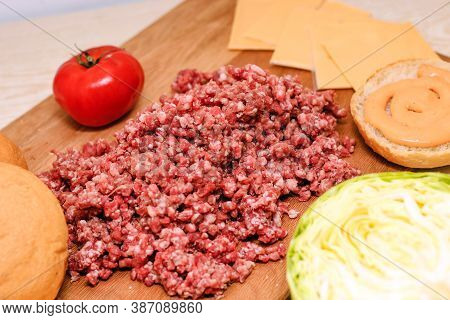 Fresh Minced Meat For Making A Burger At Home. Ingredients For A Homemade Cheeseburger.