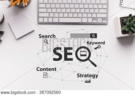 Seo Strategy. Seo-optimization Scheme With Words Over White Office Desk Background With Computer Key