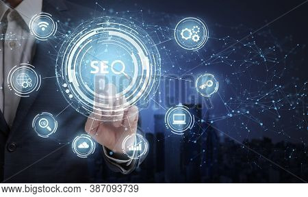 Businessman Pushing Word Seo Key For Web Content Seo-optimization For His It Business Standing Over