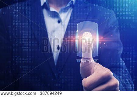 Businessman Scanning Fingerprint For Biometric Verification Pushing Key On Virtual Panel For Identif