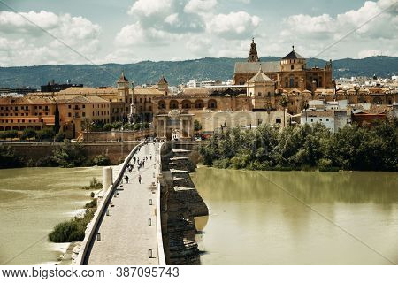 Pedestrian and bridge with Mosque-Cathedral of Cordoba in Spain.