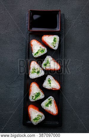 Seafood Delicatessen Salmon Sushi Rolls On Plate. Food Delivery, Restaurant Gourmet Snack, Japanese