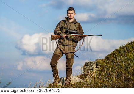 The Man Is On The Hunt. Hunt Hunting Rifle. Hunter With Hunting Gun And Hunting Form To Hunt Sky Bac