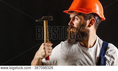 Builder In Helmet, Hammer, Handyman, Builders In Hardhat. Bearded Builder Isolated On Black Backgrou