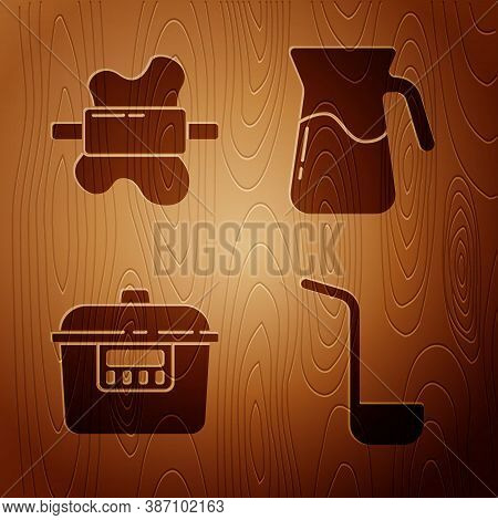 Set Kitchen Ladle, Rolling Pin On Dough, Slow Cooker And Jug Glass With Water On Wooden Background.