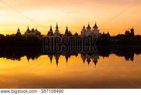 Awe Orange Sunset Over Blurry Reflection Of The Izmailovsky Kremlin In The Lake Water At Moscow, Rus