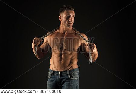 Remove Shackles. Strong Enough To Be Free. Bodybuilder Concept. Healthy And Strong. Masculine Sport.
