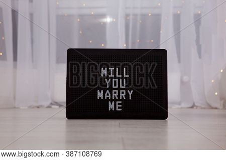 Will You Marry Me. The Inscription On The Card To A Friend. Greeting For A Wedding Proposal With Can
