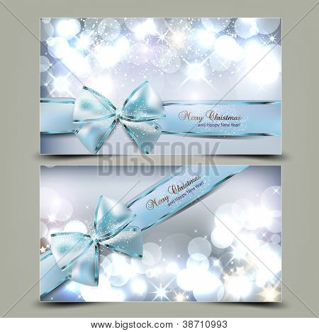Elegante Weihnachtskarten mit blauen Bögen und Platz für Text. Vektor-Illustration.