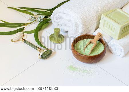Anti-aging Skin Care Tools. Eucalyptus Salt, Soap On The White Background. Gua Sha Jade Gem And Jade