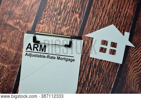 Arm - Adjustable-rate Mortgage Write On A Paperwork Isolated On Office Desk.