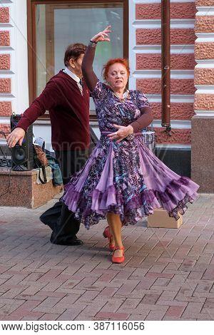 Lovely Senior Couple Dancing On City Street. Elderly People Lifestyle Concept. Senior People Activit