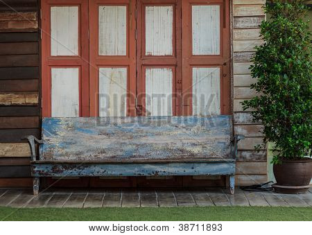 Old Wooden Chair In Front Of The Door