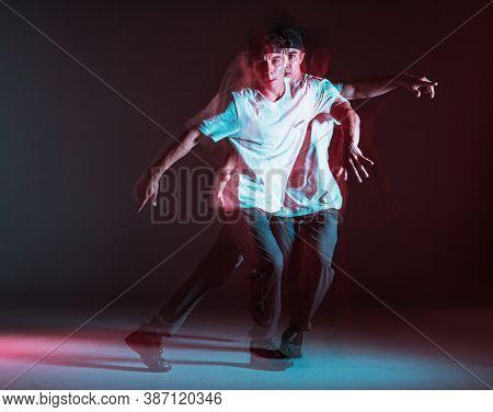 Cool Guy Breakdancer Dancing Hip-hop In Neon Light. Dance School Poster. Long Exposure Shot