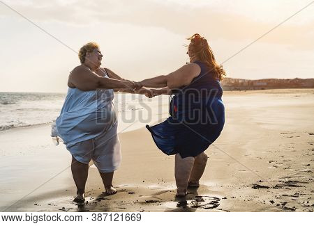Happy Plus Size Women Dancing On The Beach - Curvy Overweight Girls Having Fun During Vacation In Tr