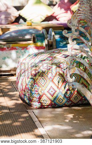 Boho style colorful poufs in garden outdoor decor
