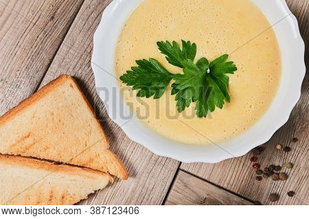 Different Kinds Of Soups - Pumpkin Soup, Cheese Cream-soup And Mushroom Cream-soup On The Table.