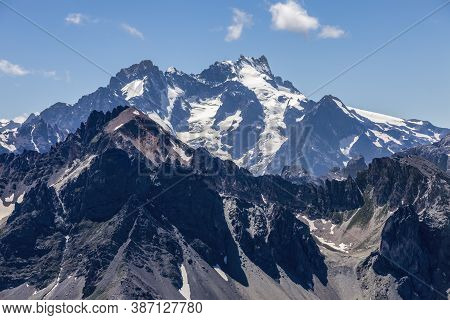 High Altitude Landscape In Alps With Snowcapped Peaks Seen From Etroite Valley In Massif Des Cerces