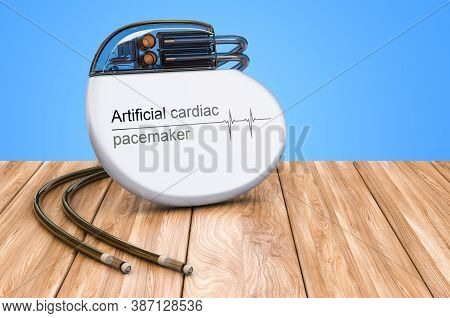 Artificial Cardiac Pacemaker On The Wooden Table, 3d Rendering