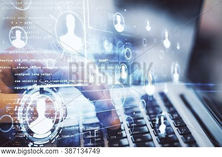 Businessman Using Laptop On Desktop With Human Resources Interface On Creative Glowing Programming B