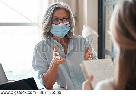 Old Middle Aged Female Mentor, Teacher, Hr Manager Wearing Face Mask Training Young Worker Intern, T