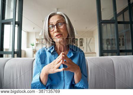 Mature 60s Old Woman Online Teacher, Remote Tutor, Distance Coach Therapist Businesswoman Talking To