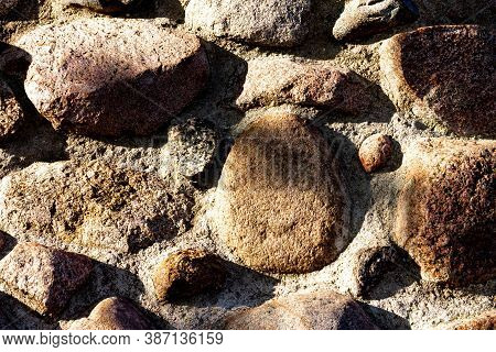 A Masonry Background With Harsh Light And Harsh Shadows. A Wall Made Of Stones.