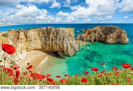 Amazing Landscape With Cliff, Beach And Turquoise Water In Algarve, Portugal