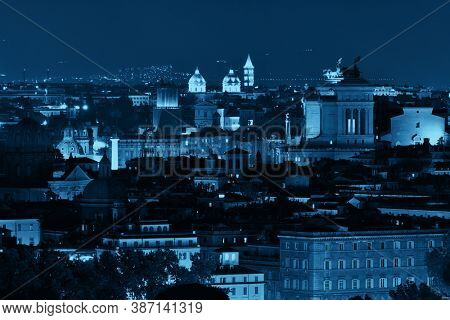 Rome rooftop view with ancient architecture in Italy at night in blue tone.