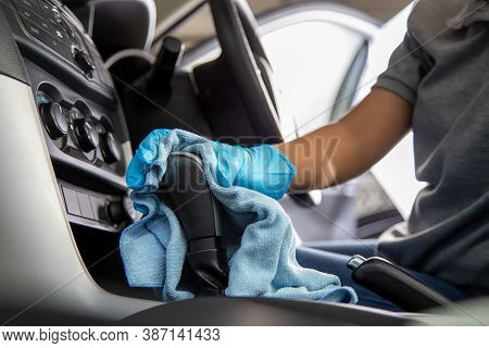 Hand Wearing Rubber Gloves Cleaning Gear Lever Or Gear Shifter With Microfiber Cloth, Clean The Car