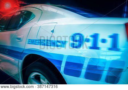 Police car siren on at night.