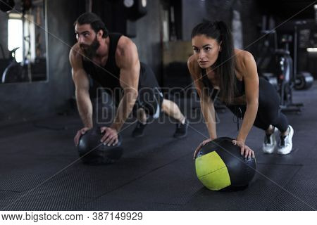 Beautiful Young Indian Sports Couple Is Working Out With Medicine Ball In Gym.