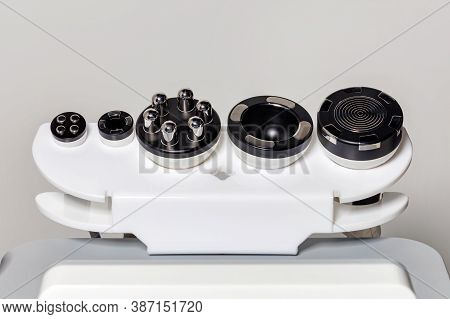 Medical Instruments For Cosmetology, Body Shaping, Liposuction And Massage, On A Gray Background, Co